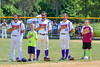 Cortland Crush players Greg Mula (1), David Murphy (8) and Paul Ludden (10) during the National Anthem before playing the Sherrill Silversmiths on Greg's Field at Beaudry Park in Cortland, New York on Sunday, June 26, 2016.