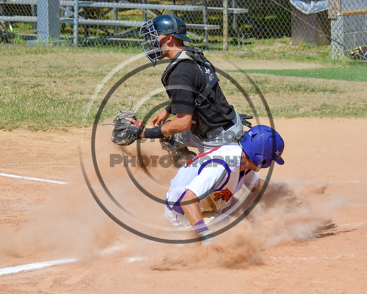 Cortland Crush Broderick Santilli (3) slides into Home Base for a run against the Sherrill Silversmiths on Greg's Field at Beaudry Park in Cortland, New York on Sunday, June 26, 2016. Cortland won 6-4.