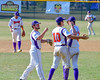 Cortland Crush players David Murphy (8), Paul Ludden (10) and William Ginsberg (30) celebrate a win over the Sherrill Silversmiths on Greg's Field at Beaudry Park in Cortland, New York on Sunday, June 26, 2016. Cortland won 6-4.