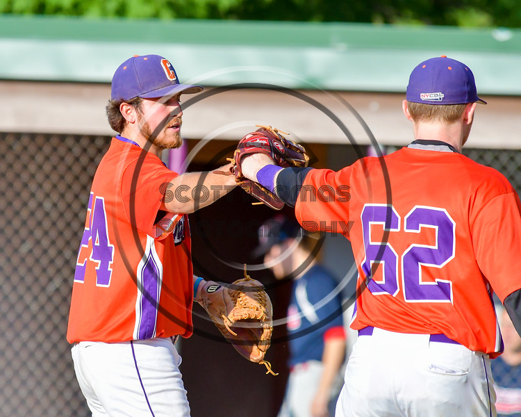 Cortland Crush Nathan Verst (24) gets a glove bump from Aaron Edelmon (62) after completing an inning against the Syracuse Salt Cats on Greg's Field at Beaudry Park in Cortland, New York on Wednesday, June 29, 2016. Cortland won 5-4 in 13 innings.