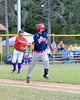 Cortland Crush Nathan Verst (24) throwing the the Syracuse Salt Cats runner out at First Base on Greg's Field at Beaudry Park in Cortland, New York on Wednesday, June 29, 2016. Cortland won 5-4 in 13 innings.