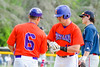Cortland Crush Ethan Moore (16) talks with Manager Bill McConnell at First Base against the Syracuse Salt Cats on Greg's Field at Beaudry Park in Cortland, New York on Wednesday, June 29, 2016. Cortland won 5-4 in 13 innings.
