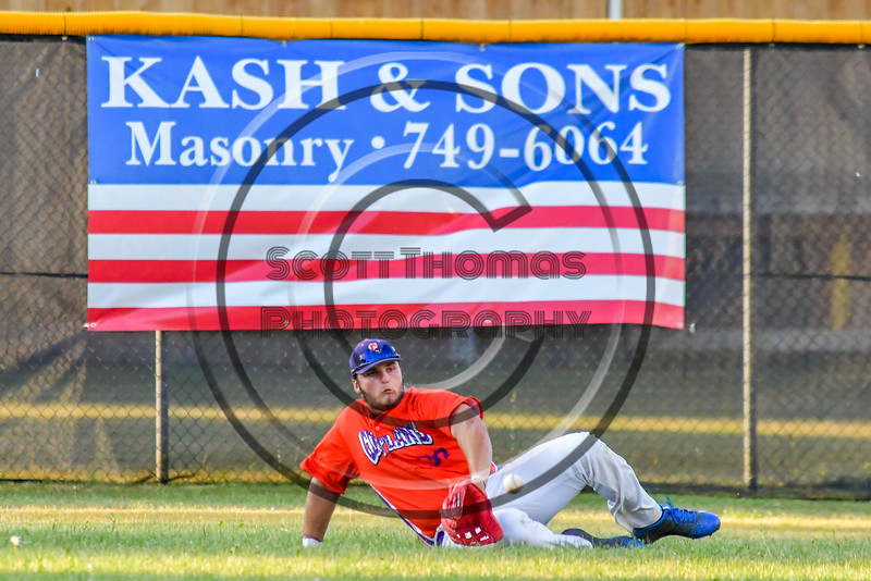 Cortland Crush Andrew Taft (32) slides to make a catch for an out against the Syracuse Salt Cats on Greg's Field at Beaudry Park in Cortland, New York on Wednesday, June 29, 2016. Cortland won 5-4 in 13 innings.