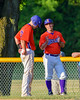 Cortland Crush Manager Bill McConnell talks with TJ Wegmann (26) at First Base against the Syracuse Salt Cats on Greg's Field at Beaudry Park in Cortland, New York on Wednesday, June 29, 2016. Cortland won 5-4 in 13 innings.