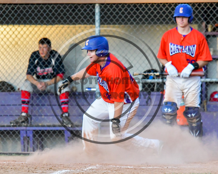 Cortland Crush Clayton Jeffries (42) slides into Home Base for a score against the Syracuse Salt Cats on Greg's Field at Beaudry Park in Cortland, New York on Wednesday, June 29, 2016. Cortland won 5-4 in 13 innings.