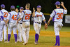 Cortland Crush players give High Fives after beating the Rome Generals on Greg's Field at Beaudry Park in Cortland, New York on Wednesday, July 6, 2016. Cortland won 7-2.