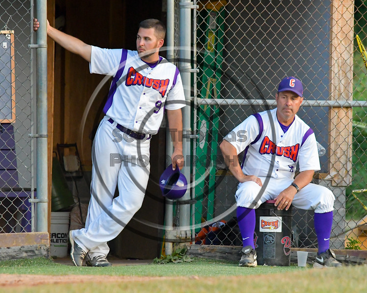 Cortland Crush Third Base Coach John Buczek (9) and Manager Bill McConnell outside the Dug Out against the Rome Generals on Greg's Field at Beaudry Park in Cortland, New York on Wednesday, July 6, 2016. Cortland won 7-2.