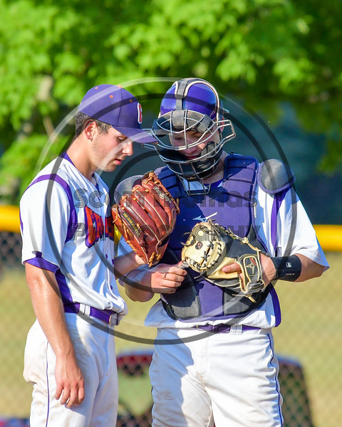 Cortland Crush Pitcher Andrew Cartier (23) confers with his catcher, TJ Wegmann (26), during a time out against the Rome Generals on Greg's Field at Beaudry Park in Cortland, New York on Wednesday, July 6, 2016. Cortland won 7-2.