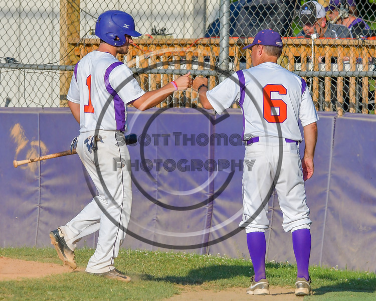 Cortland Crush Greg Mula (1) is greeted by Manager Bill McConnell after scoring a run against the Rome Generals on Greg's Field at Beaudry Park in Cortland, New York on Wednesday, July 6, 2016. Cortland won 7-2.