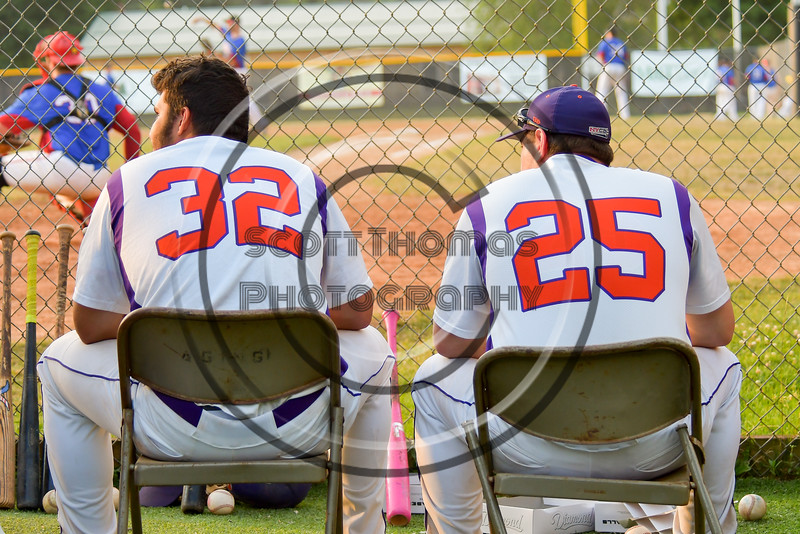 Cortland Crush players Andrew Taft (32) and First Base Coach Zephan Kash (25) watch the game against the Rome Generals on Greg's Field at Beaudry Park in Cortland, New York on Wednesday, July 6, 2016. Cortland won 7-2.