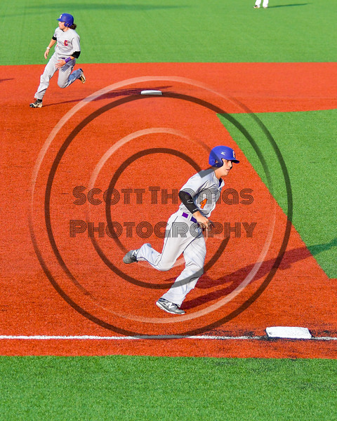 Cortland Crush Joey Assenza (4) and Luke Gilbert (5) running the bases against the Syracuse Salt Cats at OCC Turf Field in Syracuse, New York on Friday, July 8, 2016. Cortland won 10-4.