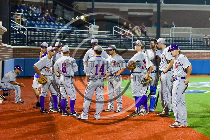 Cortland Crush Manager Bill McConnell talks with his players after the 8th inning against the Syracuse Salt Cats at OCC Turf Field in Syracuse, New York on Friday, July 8, 2016. Cortland won 10-4.