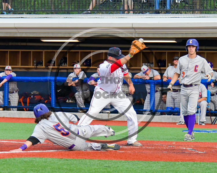 Cortland Crush Luke Gilbert (5) slides into Home for a run against the Syracuse Salt Cats at OCC Turf Field in Syracuse, New York on Friday, July 8, 2016. Cortland won 10-4.