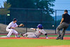 Cortland Crush Luke Gilbert (5) sliding into Third Base agianst the Syracuse Salt Cats at OCC Turf Field in Syracuse, New York on Friday, July 8, 2016. Cortland won 10-4.