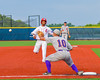 Cortland Crush Paul Ludden (10) receives the ball before the Syracuse Salt Cats base runner gets to Thrid Base at OCC Turf Field in Syracuse, New York on Friday, July 8, 2016. Cortland won 10-4.