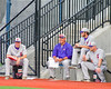 Cortland Crush Pitching Coach Daniel Payne (44) with Stephan Witkowski (17), Nathan Verst (24) and First Base Coach Zephan Kash (25) during a game against the Syracuse Salt Cats at OCC Turf Field in Syracuse, New York on Friday, July 8, 2016. Cortland won 10-4.