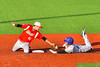 Syracuse Junior Chiefs Tristan Dacey (41) tags  Cortland Crush David Murphy (8) out at Second Base at OCC Turf Field in Syracuse, New York on Sunday, July 10, 2016. Syracuse won 6-1.