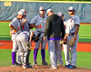 Cortland Crush Pitching Coach Daniel Payne (44) confers with this players during a timeout against the Syracuse Junior Chiefs at OCC Turf Field in Syracuse, New York on Sunday, July 10, 2016. Syracuse won 6-1.