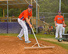 Cortland Crush Stephan Witkowski (17) doing field prep before the game with the Rome Generals on Greg's Field at Beaudry Park in Cortland, New York on Wednesday, July 16, 2016.