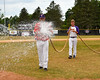 Cortland Crush players doing field prep before the game with the Rome Generals on Greg's Field at Beaudry Park in Cortland, New York on Wednesday, July 16, 2016.