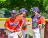 Cortland Crush Paul Ludden (10) returns to Third Base after talking with Clayton Jeffries (42) and TJ Wegmann (26) during a timeout in a game against the Sherrill Silversmiths on Greg's Field at Beaudry Park in Cortland, New York on Thursday, July 21, 2016. Cortland won 3-2.