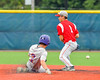 Cortland Crush Broderick Santilli (3) slides into Second Base as Syracuse Junior Chiefs John Militano (1) mishandles the ball at OCC Turf Field in the NYCBL Eastern Division playoffs in Syracuse, New York on Thursday, July 28, 2016. Syracuse won 4-3.