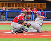 Cortland Crush Andrew Taft (32) is tagged out at Home Plate by Syracuse Junior Chiefs Joe DeLuca (25) at OCC Turf Field in the NYCBL Eastern Division playoffs in Syracuse, New York on Thursday, July 28, 2016. Syracuse won 4-3.
