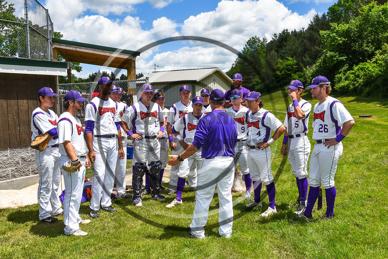 Cortland Crush players listen to their Head Coach Kevin Foley before playing the Syracuse Spartans on Greg's Field at Beaudry Park in Cortland, New York on Saturday, June 3, 2017.
