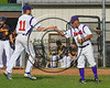 Cortland Crush Manager Bill McConnell fist bumps Alex Flock (11) against the Syracuse Spartans on Greg's Field at Beaudry Park in Cortland, New York on Friday, June 16, 2017. Cortland won 10-4.