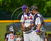 Cortland Crush Jacob Williamson (28) talks with TJ Wegmann (10) during a timeout against the Syracuse Spartans on Greg's Field at Beaudry Park in Cortland, New York on Friday, June 16, 2017. Cortland won 10-4.