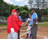 Cortland Crush Manager Bill McConnell and Syracuse Salt Cats Manager Mike Martinez in the pre-game meeting with the Umpires on Greg's Field at Beaudry Park in Cortland, New York on Saturday, June 17, 2017.