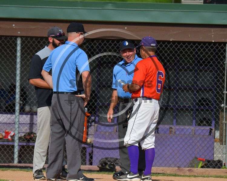 Cortland Crush Manager Bill McConnell in the pre-game meeting with Umpires and Sherrill Silversmiths Manger on Greg's Field at Beaudry Park in Cortland, New York on Thursday, June 22, 2017. Cortland won 10-9.