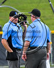 Umpires consult on a call during a game between the Cortland Crush and Syracuse Spartans on Dick Rockwell Field at LeMoyne College in Syracuse, New York on Saturday, June 24, 2017. Cortland won 3-1.