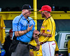 Syracuse Spartans Manager complains to the Home Plate Umpire about a call against the Cortland Crush on Dick Rockwell Field at LeMoyne College in Syracuse, New York on Saturday, June 24, 2017. Cortland won 3-1.