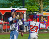 Cortland Crush Will Ginsberg (30) gets congratulated after striking out a Syracuse Salt Cats batter by Josh Reuter (23) at Wallace Field on the SUNY Cortland campus in Cortland, New York on Thuesday, June 27, 2017. Syracuse won 4-3.