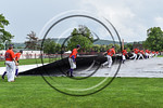 Cortland Crush players removing the tarp to resume play against the Olean Oilers at Wallace Field on the SUNY Cortland campus in Cortland, New York on Thuesday, July 2, 2017. Cortland won 7- ...