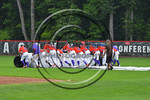 Cortland Crush players rolling out the tarp during a rain delay in the game against the Olean Oilers at Wallace Field on the SUNY Cortland campus in Cortland, New York on Thuesday, July 2, 2 ...