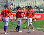 Cortland Crush Alex Flock (11) gets high fives after scoring a run against the Olean Oilers at Wallace Field on the SUNY Cortland campus in Cortland, New York on Thuesday, July 2, 2017. Cort ...