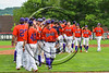 Cortland Crush players celebrate a win over the Olean Oilers at Wallace Field on the SUNY Cortland campus in Cortland, New York on Thuesday, July 2, 2017. Cortland won 7-2.