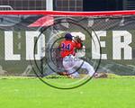 Cortland Crush Charles Edwards (24) crashes into the fence after catching the ball for an out against the Olean Oilers at Wallace Field on the SUNY Cortland campus in Cortland, New York on T ...