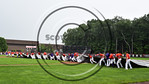 Cortland Crush players dragging the tarp over the infield during a rain delay in a game against the Olean Oilers at Wallace Field on the SUNY Cortland campus in Cortland, New York on Thuesda ...