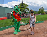 Cortland Crush mascot Homer with a fan at Wallace Field on the SUNY Cortland campus in Cortland, New York on Thuesday, July 2, 2017.