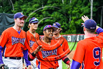 Cortland Crush Charles Edwards (24) gets congratulated after scoring a run against the Olean Oilers at Wallace Field on the SUNY Cortland campus in Cortland, New York on Thuesday, July 2, 20 ...