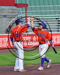 Cortland Crush Josh Reuter (23) is congratulated by Joseph Rogers (9) after scoring a run against the Olean Oilers at Wallace Field on the SUNY Cortland campus in Cortland, New York on Thues ...