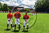 Cortland Crush players Dylan Ott (4), Tyler Schmidt (21) and Josh Reuter (23) standing for the National Anthem before playing the Olean Oilers at Wallace Field on the SUNY Cortland campus in Cortland, New York on Thuesday, July 2, 2017.