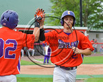 Cortland Crush Tyler Schmidt (21) after scoring a run against the Olean Oilers at Wallace Field on the SUNY Cortland campus in Cortland, New York on Thuesday, July 2, 2017. Cortland won 7-2.