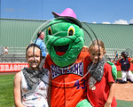 Cortland Crush mascot, Homer, poses with fans at Wallace Field on the SUNY Cortland campus in Cortland, New York on Thuesday, July 2, 2017.