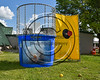 Cortland Crush Brett Wilkes (29) getting dunked in the Dunk Tank at Wallace Field on the SUNY Cortland campus in Cortland, New York on Tuesday, July 4, 2017.