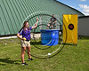 Cortland Crush Event Director Lorin Williams getting ready to dunk Brett Wilkes (29) into the Dunk Tank at Wallace Field on the SUNY Cortland campus in Cortland, New York on Tuesday, July 4, 2017.