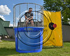 Cortland Crush Brett Wilkes (29) in the Dunk Tank at Wallace Field on the SUNY Cortland campus in Cortland, New York on Tuesday, July 4, 2017.